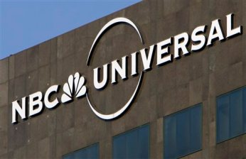 "FILE - This Thursday, Dec. 3, 2009, file photo, the NBC Universal logo hangs on a building in Los Angeles. NBCUniversal will pay $6.4 million to settle a class action lawsuit brought by unpaid interns who worked on ""Saturday Night Live"" and other shows who claim they are owed wages, according to court documents. (AP Photo/Jae C. Hong, File)"